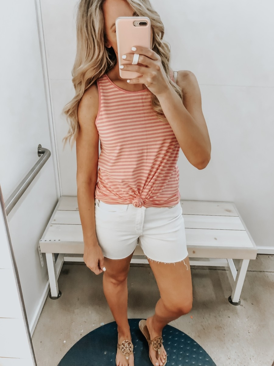 Best Memorial Day Weekend Sales featured by top US fashion blog Haute & Humid; Image of a woman wearing Old Navy striped tank top and Old Navy white denim shorts.