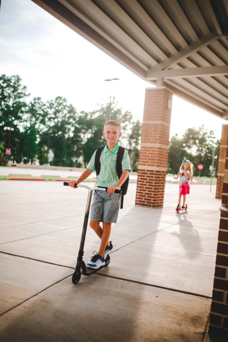 razor scooter   Walmart Back To School Shopping by popular Florida fashion blog, Haute and Humid: image of a boy and girl wearing Walmart back- to-school outfits and standing on their scooters in front of their elementary school. The girls is wearing a Walmart 365 Kids From Garanimals Flutter Graphic Tank Top, 65 Kids From Garanimals Shimmer Foil Pleated Skirt, and Wonder Nation Solid and Printed Bike Shorts, 2-Pack. The boy is wearing Walmart Athletic Works Boys' Slip On Cage Athletic Shoes, green Wonder Nation Short Sleeve Stretch Jersey Polo, and Wonder Nation Rib Waist Pull on Short.