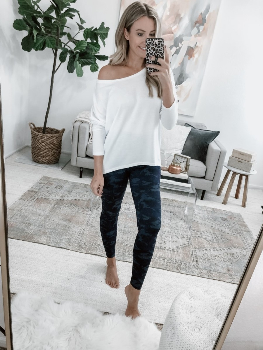 camo leggings | 5 Best Amazon Leggings Reviewed And Rated by popular Houston fashion blog, Haute and Humid: image of a woman wearing Amazon Brand - Core 10 Women's (XS-3X) All Day Comfort High Waist Full-Length Yoga Legging and UGET Women's Sweater.