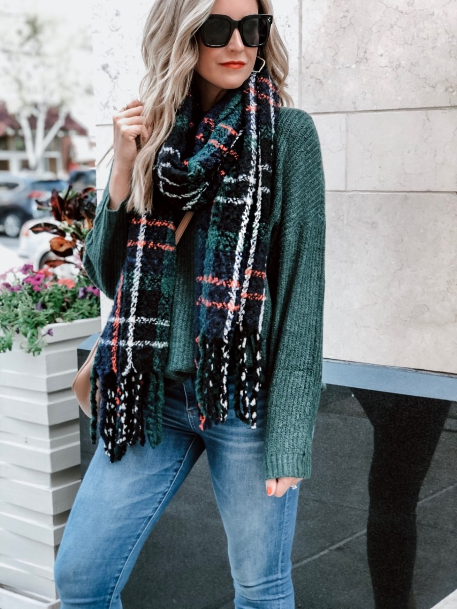 black friday sales | The Best Black Friday Shopping Guide by popular Houston life and style blog, Haute and Humid: image of a woman wearing an American Eagle AE OVERSIZED SOFTEST CREW NECK SWEATER, Old Navy Patterned Bouclé-Knit Blanket Scarf for Women, Quay It's My Way Sunglasses, and Kendra Scott Earrings.
