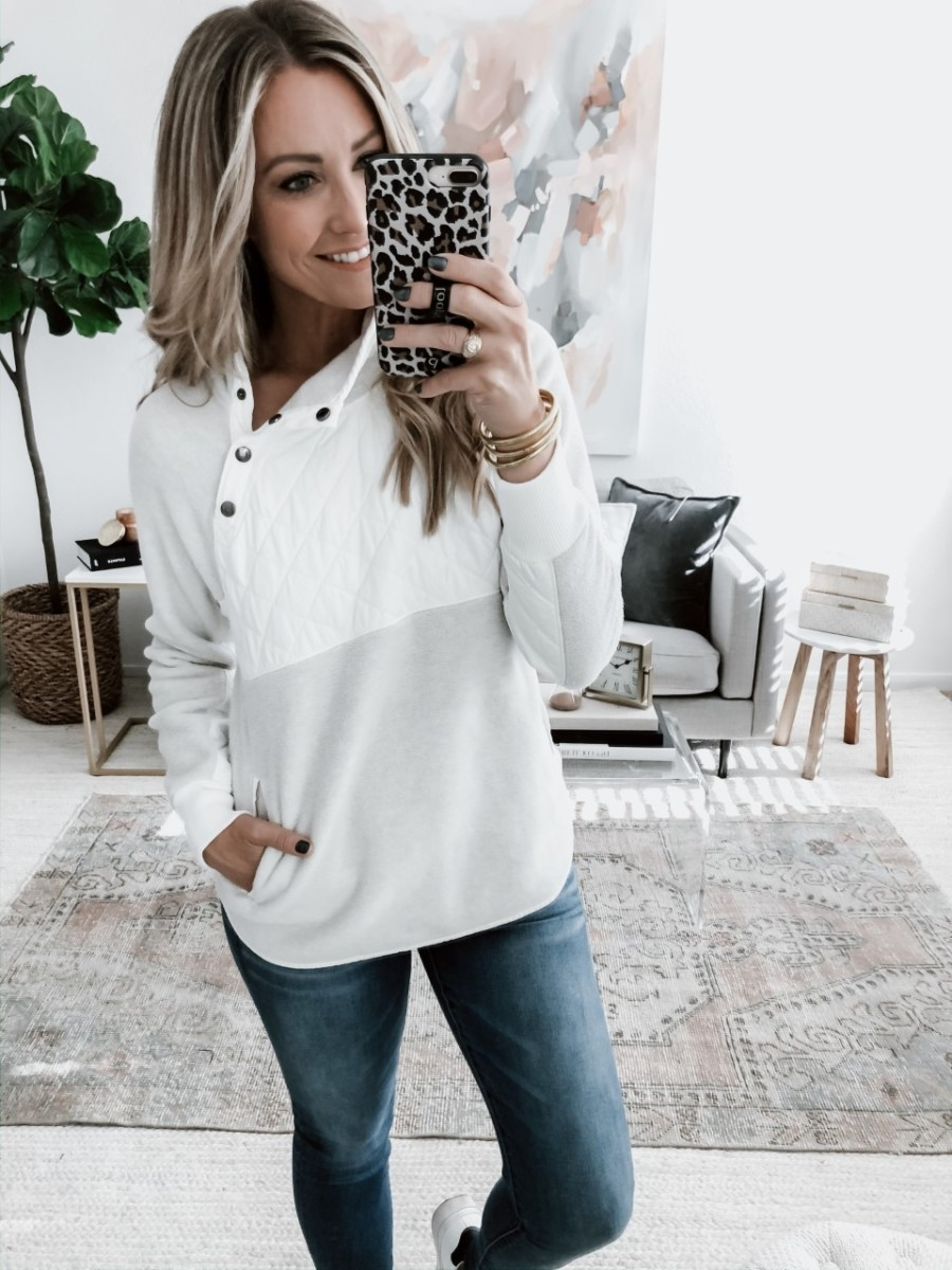 abercrombie black friday | The Best Black Friday Shopping Guide by popular Houston life and style blog, Haute and Humid: image of a woman wearing a Abercrombie and Fitch pullover.