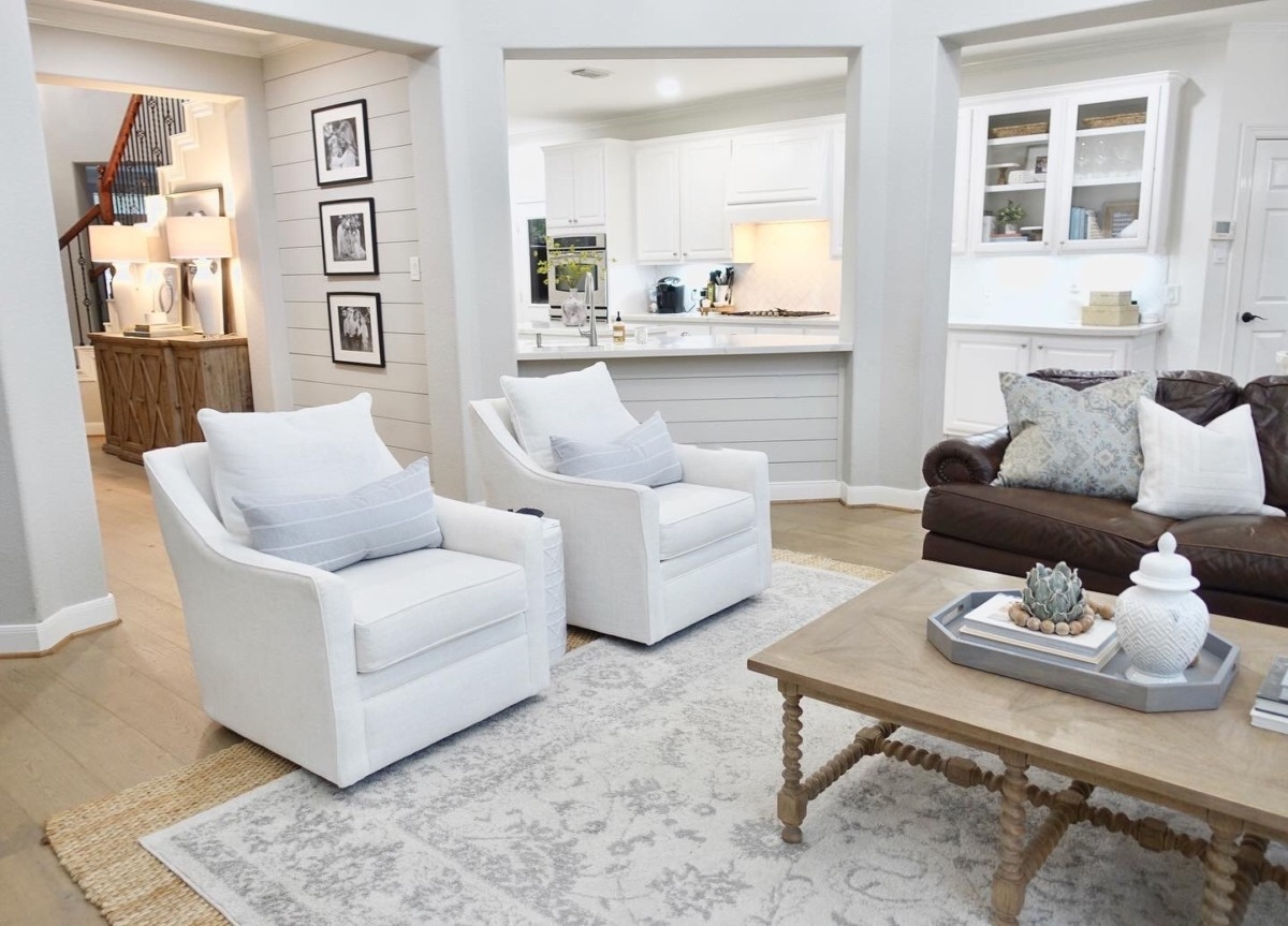 living room remodel    Living Room Makeover by popular Houston lifestyle blog, Haute and Humid: image of a remodeled living room and kitchen.