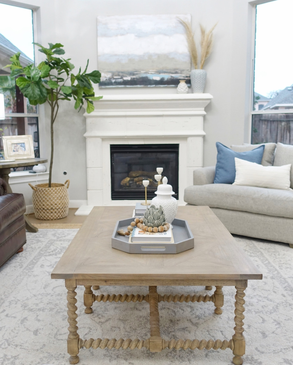 mantle decor | Living Room Makeover by popular Houston lifestyle blog, Haute and Humid: image of a remodeled living room with a Wayfair Shayla 20-Light Candle Style Wagon Wheel Chandelier, Wisteria Barley Twist Coffee Table, and Perigold ARIANA VERNAY RECTANGULAR CONSOLE TABLE.
