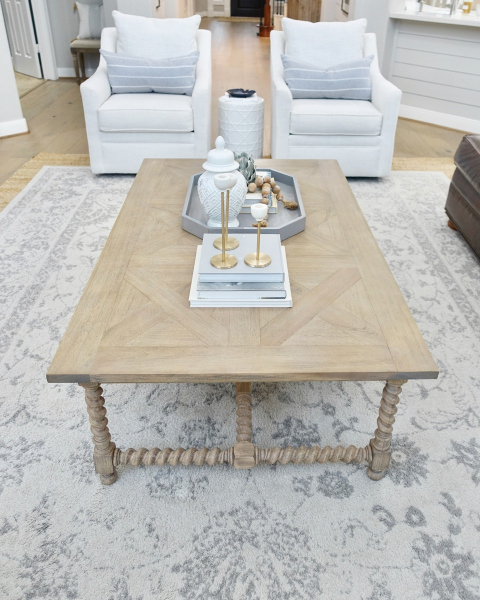rectangle coffee table | Living Room Makeover by popular Houston lifestyle blog, Haute and Humid: image of a remodeled living room with a Wayfair Shayla 20-Light Candle Style Wagon Wheel Chandelier, Wisteria Barley Twist Coffee Table, and Perigold ARIANA VERNAY RECTANGULAR CONSOLE TABLE.