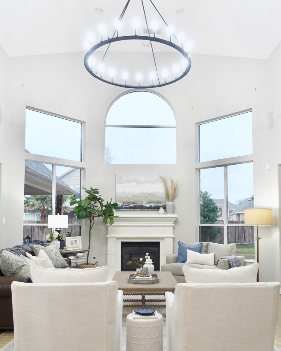 living room remodel   Living Room Makeover by popular Houston lifestyle blog, Haute and Humid: image of a remodeled living room with a Wayfair Shayla 20-Light Candle Style Wagon Wheel Chandelier.