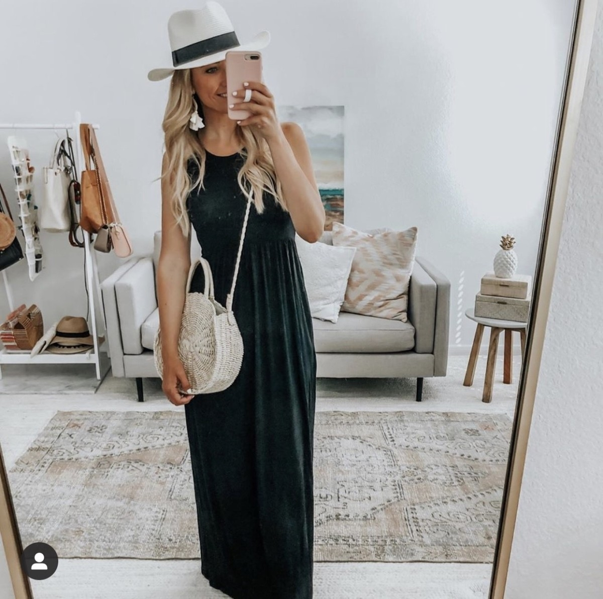 black maxi dress | Complete Guide To Affordable Resort Wear by popular Houston fashion blog: image of a woman wearing a Amazon Lanzom Women Wide Brim Straw Panama Roll up Hat, Amazon Women Straw Summer Beach Bag Handwoven Round Rattan Bag, and Amazon Meangel Rattan Tassel Earrings for Women Bohemian Statement Handmade Woven Drop Dangle Earrings.