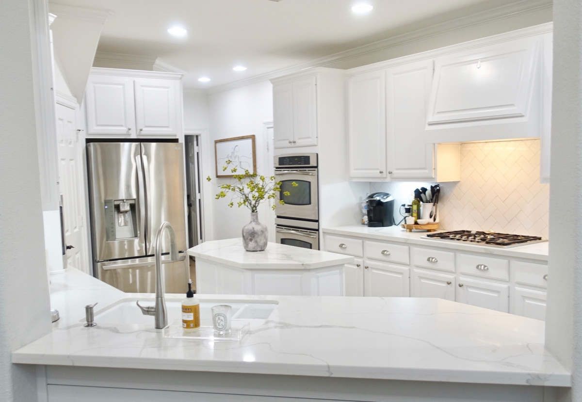 kitchen remodel | Living Room Makeover by popular Houston lifestyle blog, Haute and Humid: image of a remodeled kitchen.
