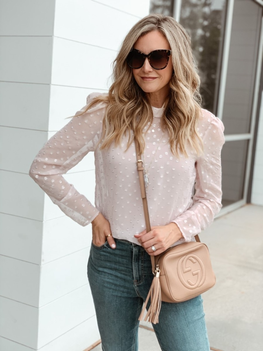 pink top | Valentine's Day Gifts Under $50 by popular Houston life and style blog, Haute and Humid: image of a woman wearing a Nordstrom Metallic Clip Dot Blouse CHELSEA28, Nordstrom The Perfect Vintage Crop High Waist Jeans MADEWELL, Nordstrom Gigietta Bootie VINCE CAMUTO, Nordstrom Reid Long Faceted Pendant Necklace KENDRA SCOTT, Nordstrom Disco Leather Bag GUCCI, Nordstrom Hollow Hoop Earrings ARGENTO VIVO, and Nordstrom 66mm Oversize Sunglasses BP..
