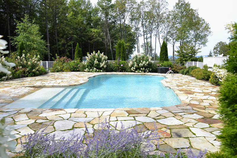 GB – zero entry pool 45′ x 18′ with resort steps, South Bay Quartzite terrace, summer flowering shrubs and perennials, aluminum pool fence
