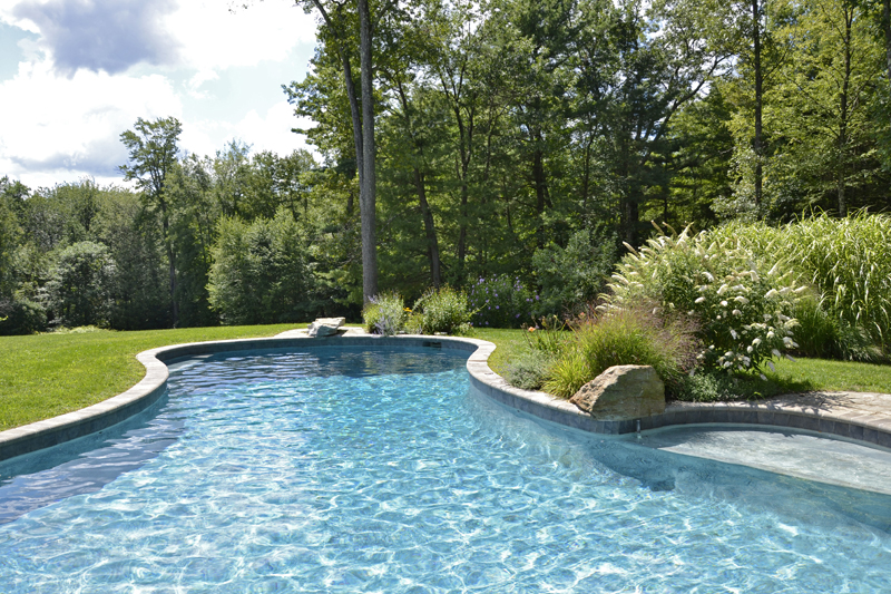 New Marlborough – curving pool 44′ x 18′ x 26′ with sunshelf, diving rocks