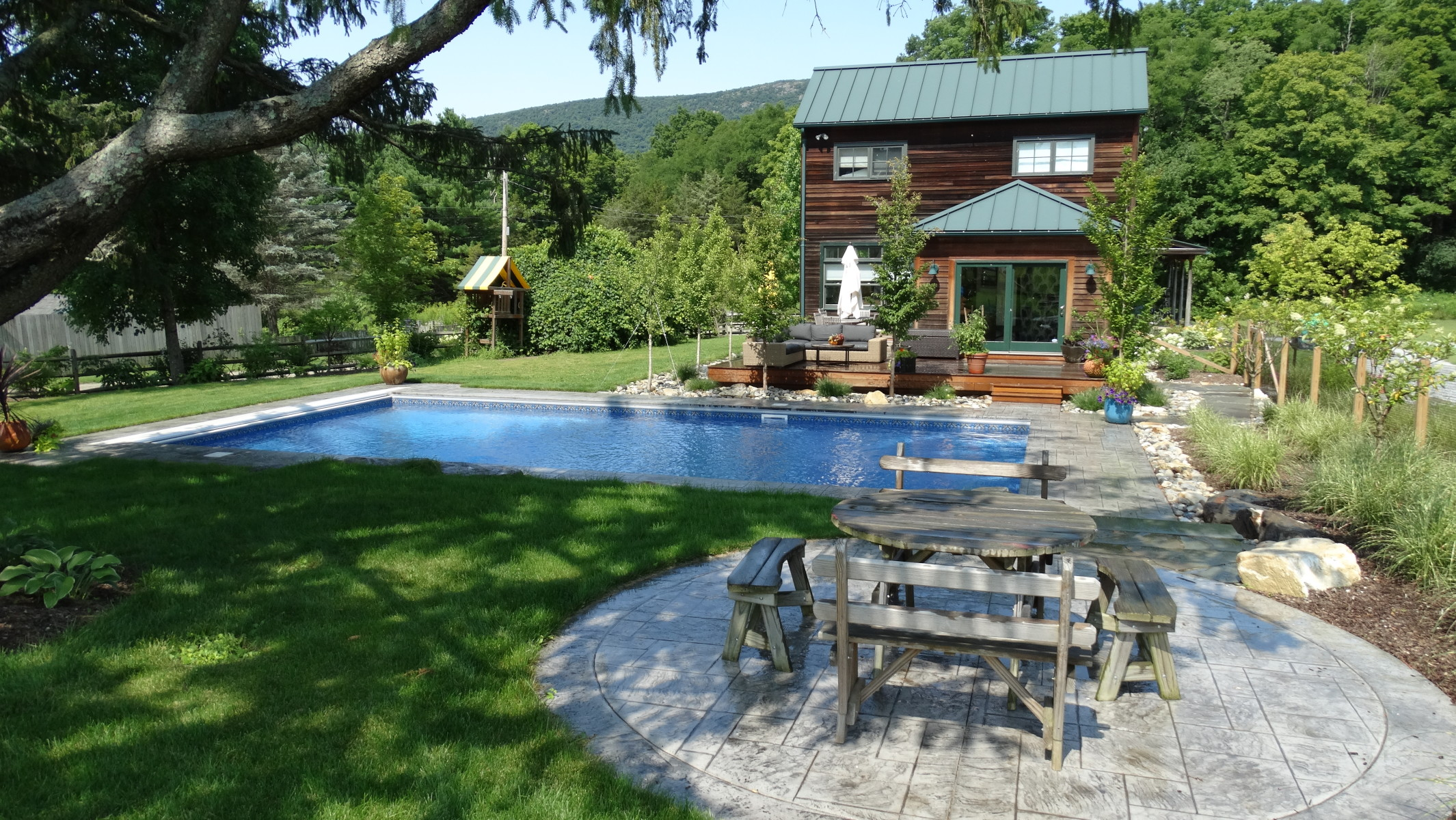 Ashley Falls pool, stamped concrete terrace, Ginkgo-Stewartia pleached shade hedget at deck