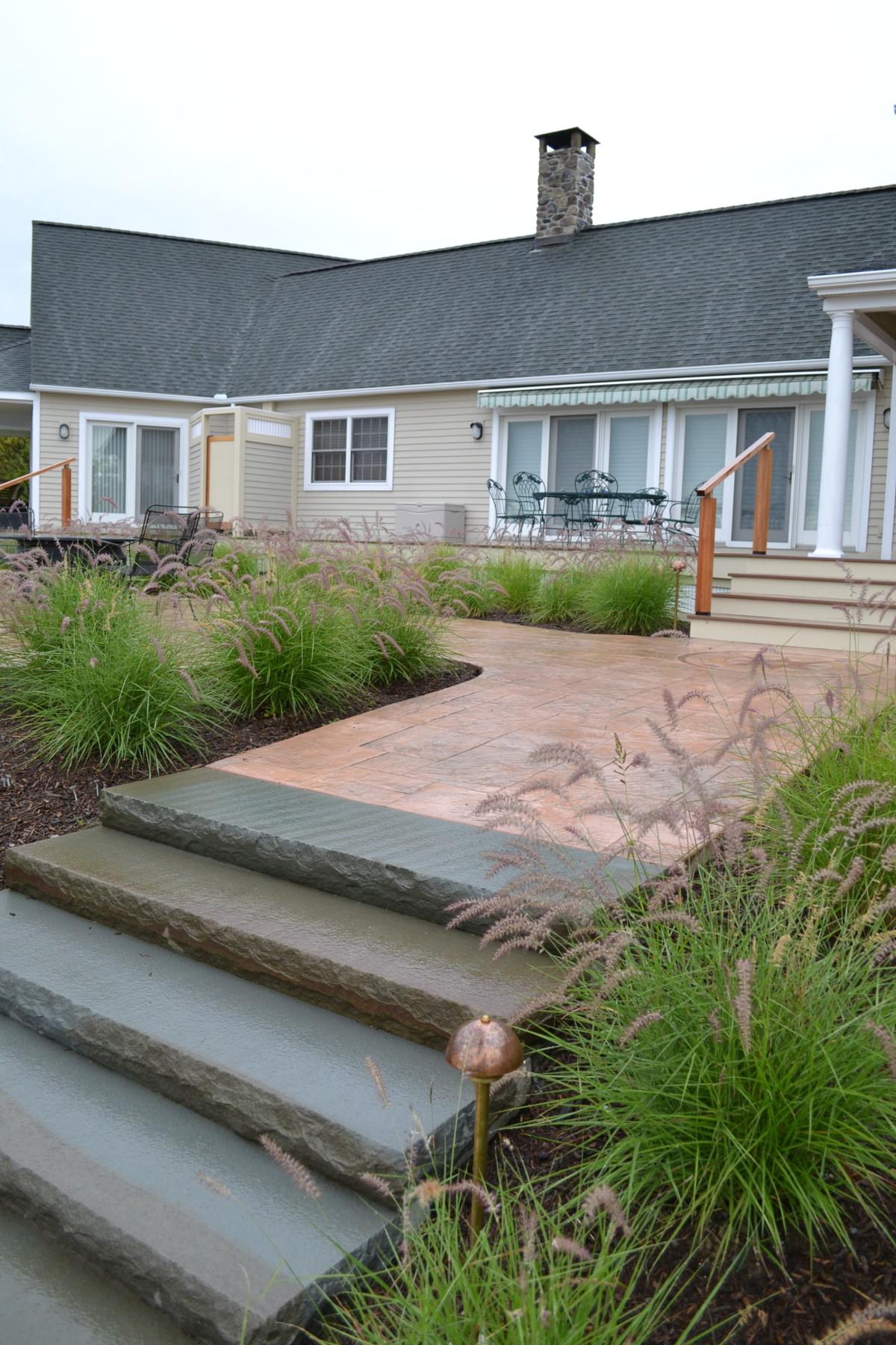 Hillsdale – late summer – solid bluestone steps, bronze path light, mass planting of Pennisetum 'Carly Rose'