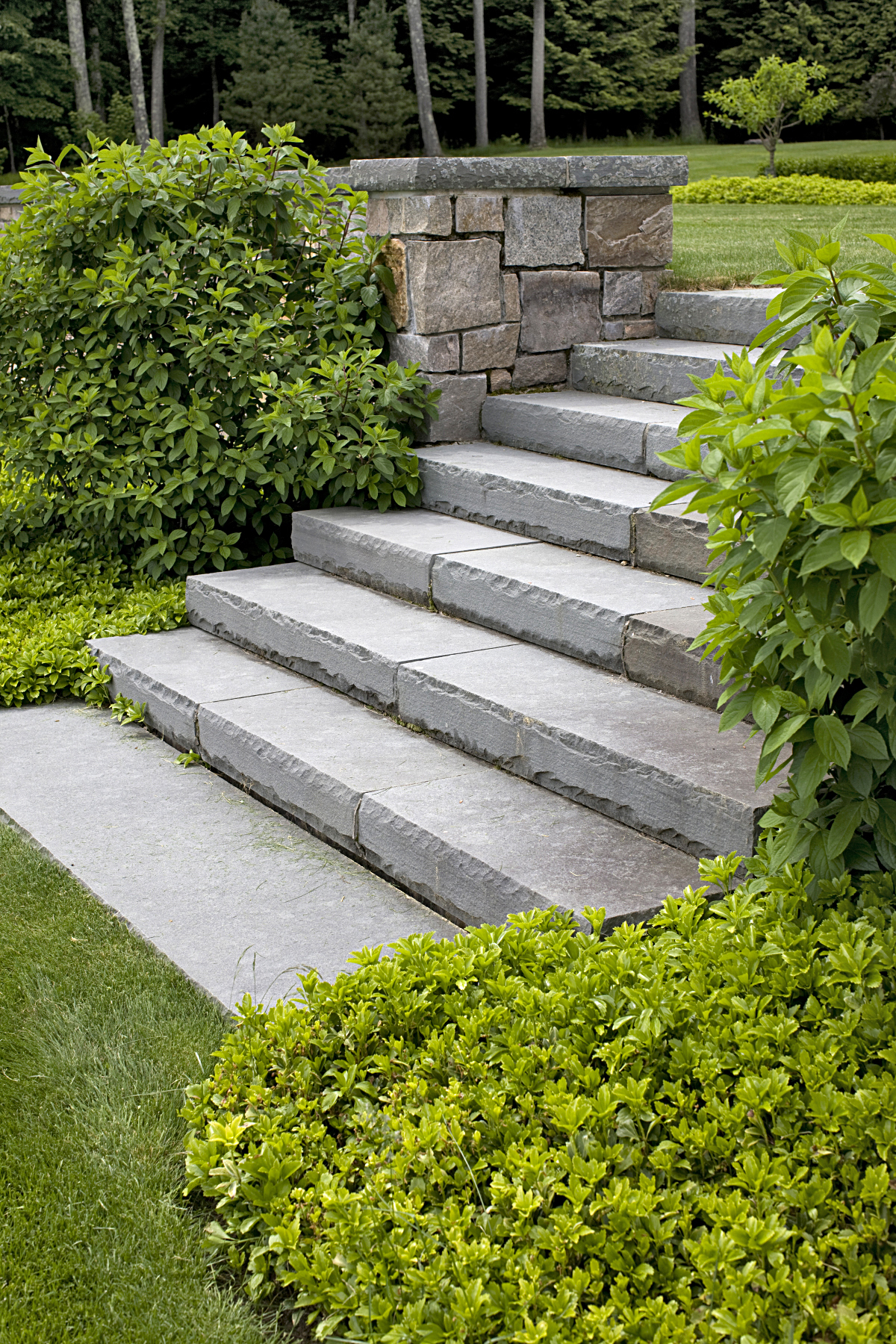 Lakeville – Solid granite steps w flamed tread & rock face treads through garden wall