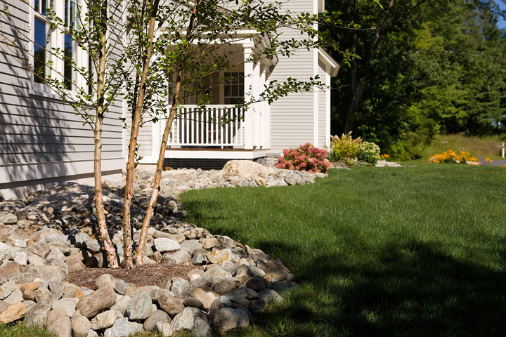 Rock-On-river-stone-vs-bark-mulch;-inserted-trees-and-low-plantings