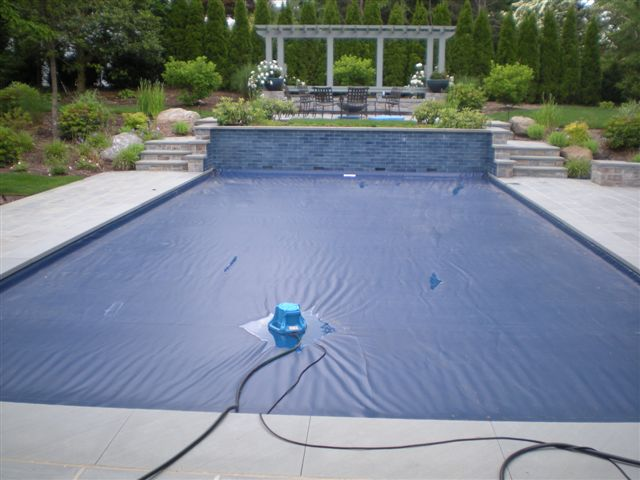 Upkeep Your Pool Cover With the Help of a Pool Cover Pump ...