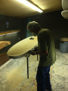 Rough shaping balsawood surfboard