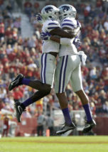 Kansas State defensive back DJ Reed, left, celebrates with teammate Kendall Adams, right, after a defensive stop during the second half of an NCAA college football game against Iowa State, Saturday, Oct. 29, 2016, in Ames, Iowa. Kansas State won the game 31-26. (AP Photo/Charlie Neibergall)