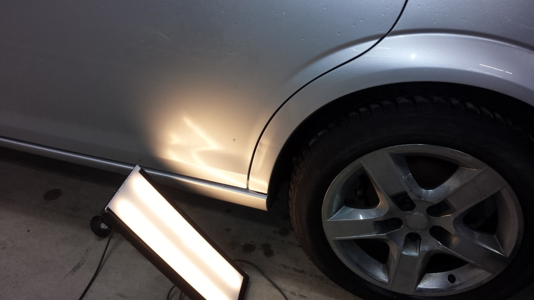 Paintless Dent Repair Phase 2 Using Diffused Lighting to See Dents