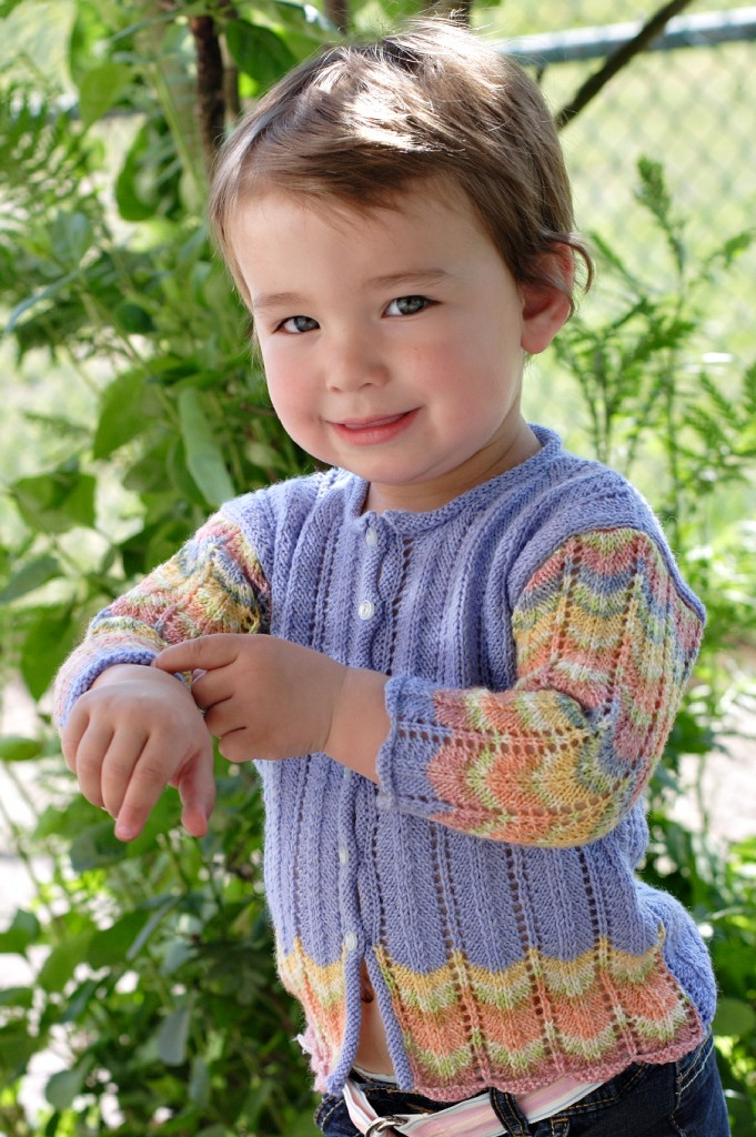 Peacock cardigan knitting pattern designed by Holli Yeoh for babies and girls