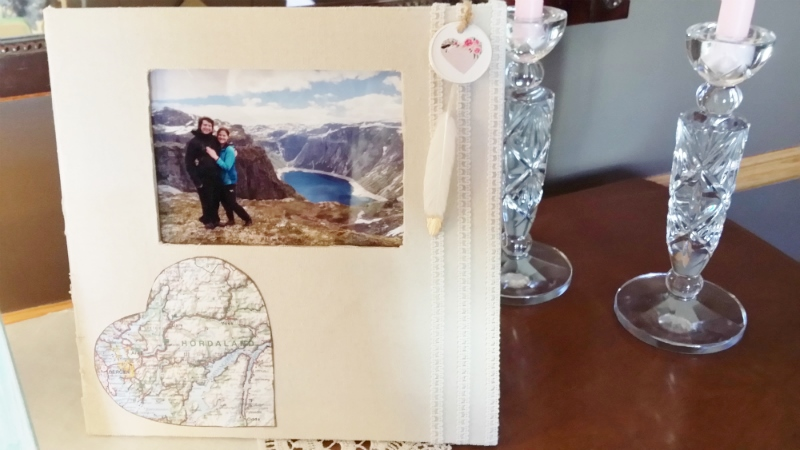 buffet table picture of their engagement with map of Norway and feather for web