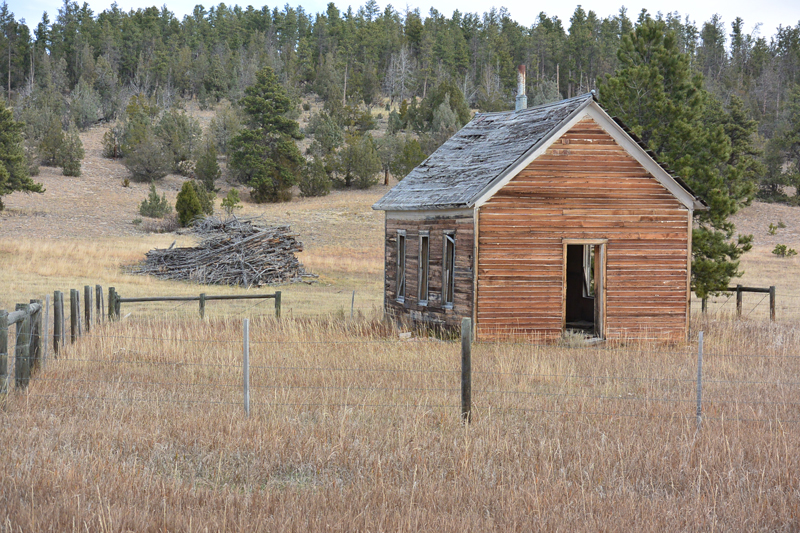 Home on the Wyoming prairie with a slash pile