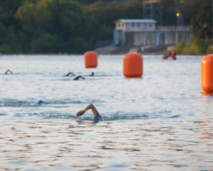 Participants swimming along the buoys in Nimitz Lake