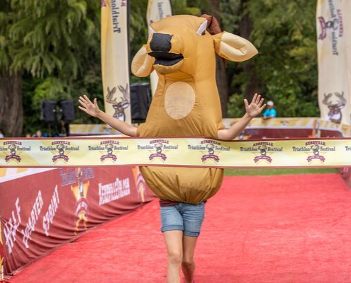 Kerrville Triathlon's mascot, Buck, crosses the finish line. Buck's ready for the largest field in Kerrville Tri history!