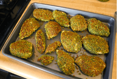 cooked gluten-free pistachio crusted chicken in a sheet pan