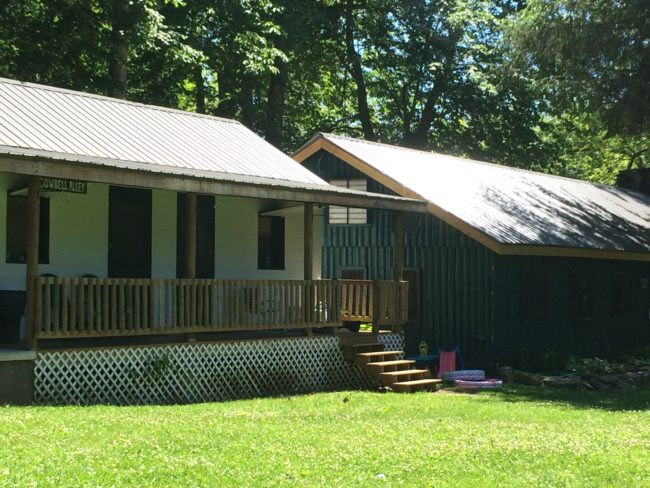 Cowbell Alley's new railing, and the Counselors' Lodge new roof.