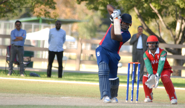 Steven Taylor drives down the ground during his knock of 124 not out against Oman. Photos by Shiek Mohamaed