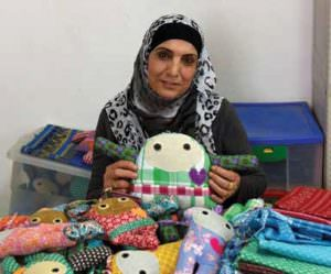 "Women make ""Jaffa Dolls"" at the Arous El Bahar women's center, a place to socialize and learn."