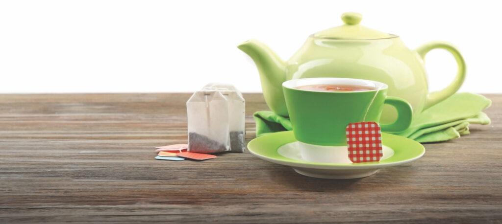 Teapot, tea cup, and tea bags.