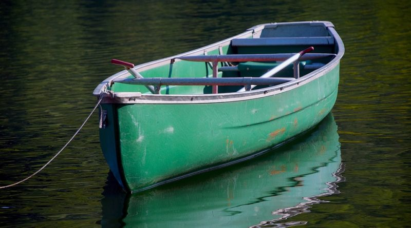 Green canoe on water