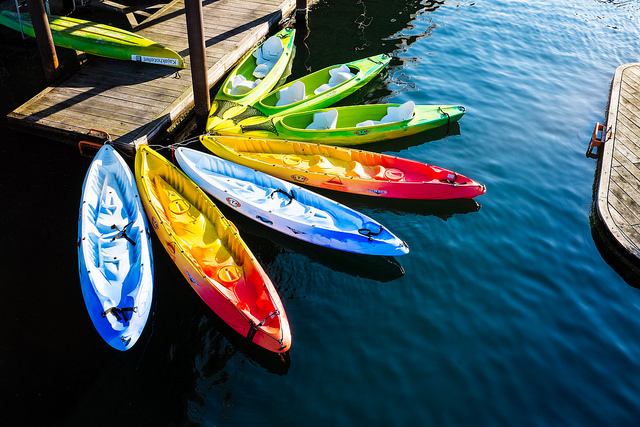 rainbow coloured sit on top kayaks