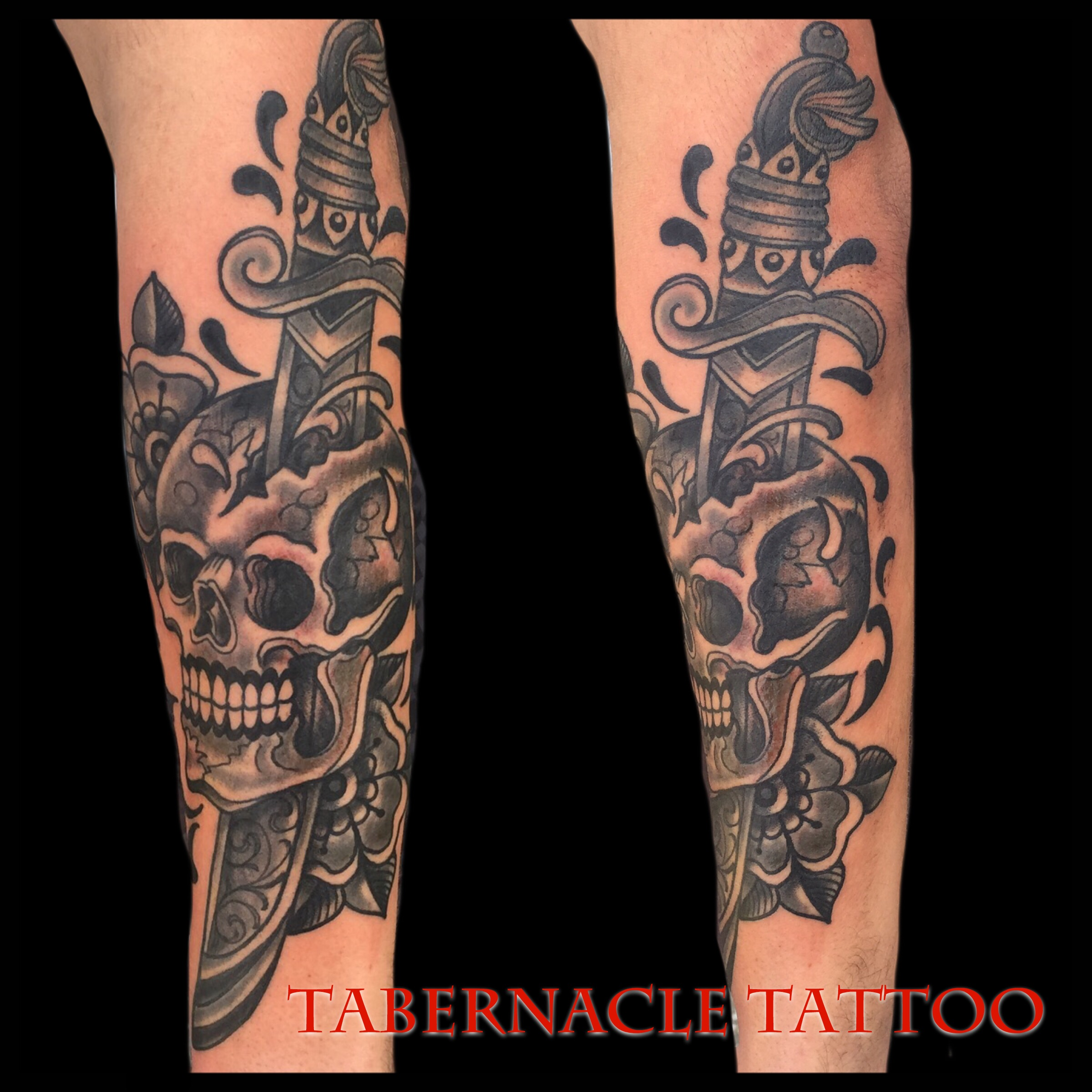Skull and dagger tattoo in black and gray