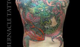 Dragon back piece tattoo