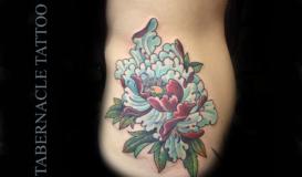 Asian Flower tattoo on girls side