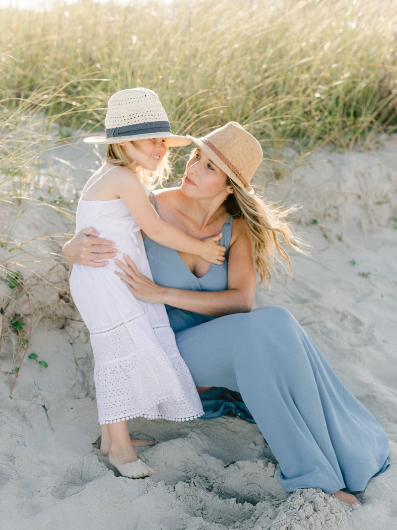 Portrait of Mom and daughter in embrace on St Simons Island beach