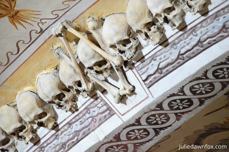Decorative skulls and paintings, Chapel of Bones, Evora
