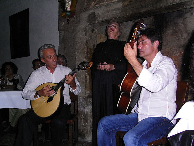 Fadistas performing in a Portuguese restaurant