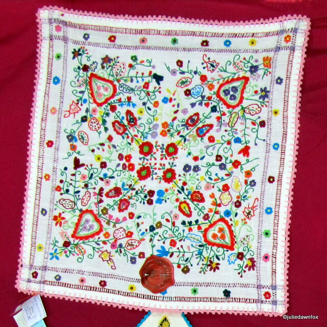 This very detailed embroidered Portuguese handkerchief has earned the seal of approval from the certifying body