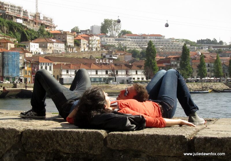 Couple basking in the sun in Porto