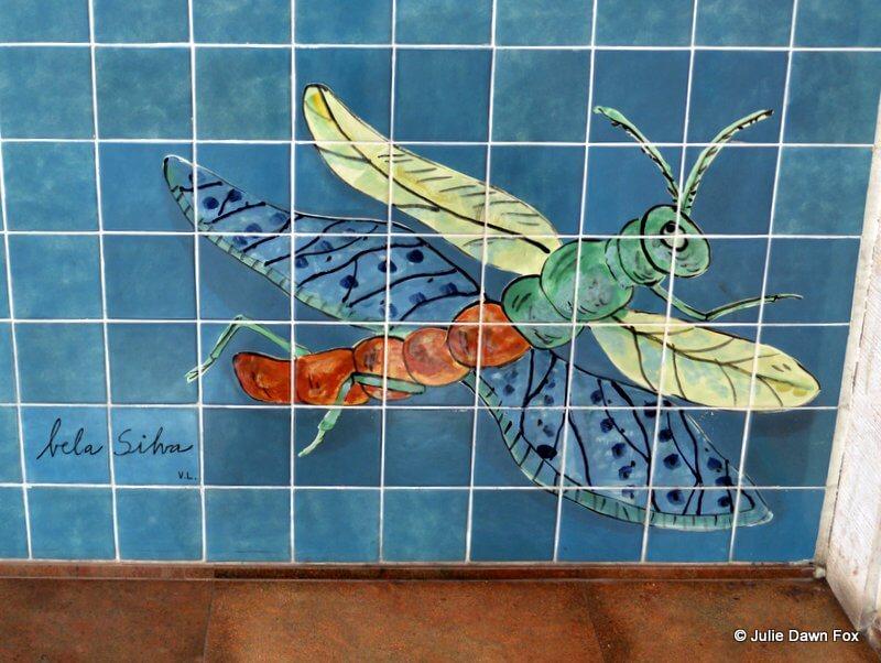 Dragonfly azulejo at Alvalade metro station in Lisbon