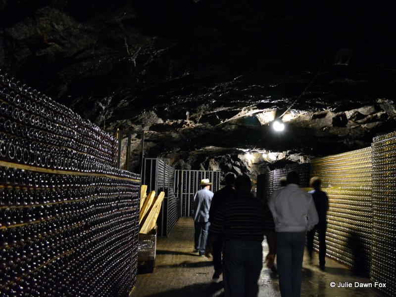 Storage caves lined with maturing bottles of sparkling wine, Murganheira wine cellars, Douro valley, Portugal