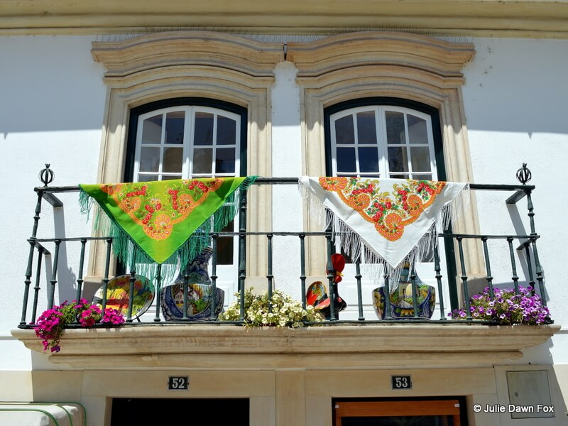Windows above souvenir shop, Alcobaça