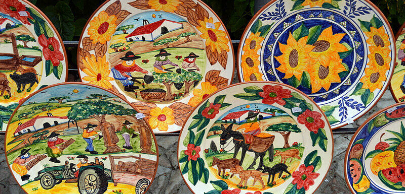 Handpainted ceramic plates with colourful country scenes, Redondo, Portugal