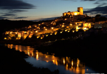 Medieval village of Mértola in the Alentejo region of Portugal at dusk. Photography by Julie Dawn Fox