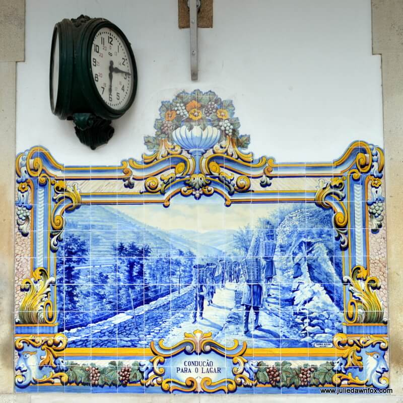 Carrying baskets of grapes, azulejo panel, Pinhão train station, Douro Valley