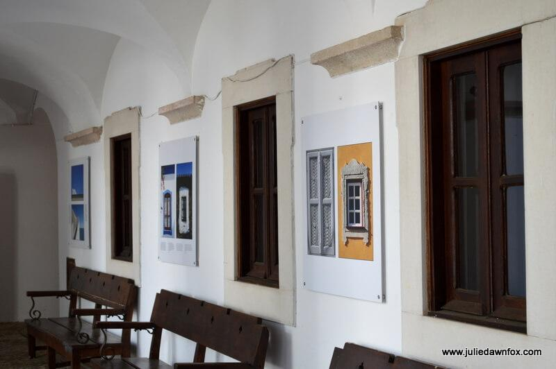 Photography exhibition in the cloisters of Galeria de Arte de Convento do Espirito Santo, Loulé, Algarve, Portugal. Photography by Julie Dawn Fox