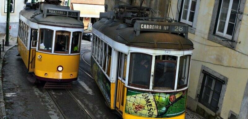 Antique wooden tram 28 in Lisbon passing on a hill in Graça